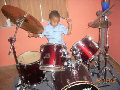My son's first exposure to drums on a trip in 2010.