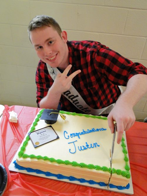 sea cadet with graduation cake